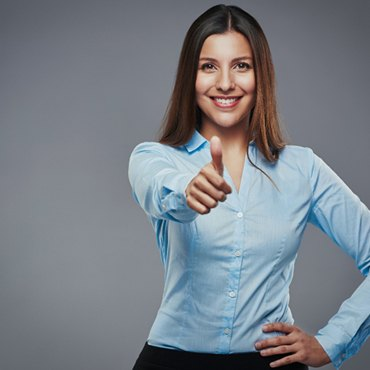 confident woman gives thumb up