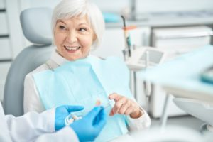 woman learns about dental implant terms you should know