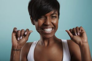 woman maintaining oral hygiene best practices