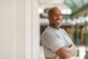 Confident, happy man with implant dentures in Glendale